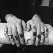 Moon phases finger tattoo
